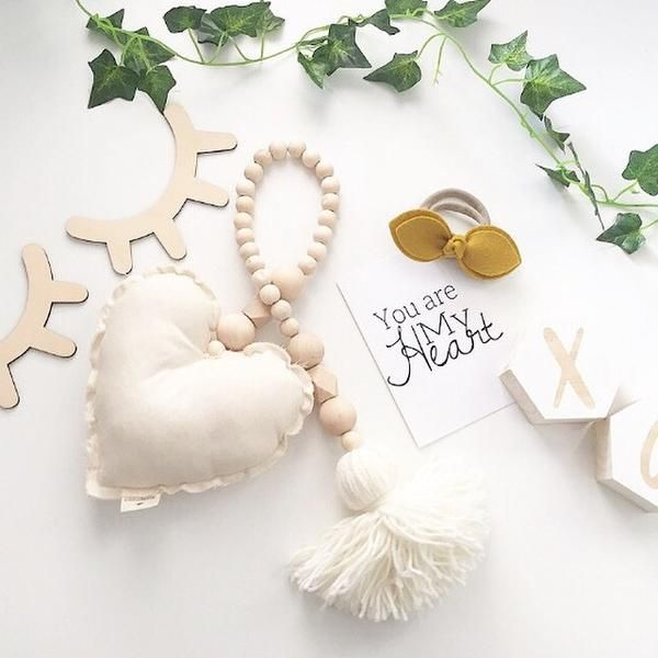 Scandi style wooden beaded garland designed and handmade in Australia by Claudette. Beautiful decor piece for nurseries, children's bedrooms and living spaces.