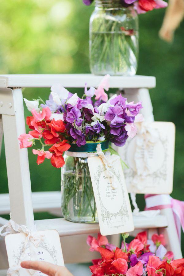 flowers in mason jars // photo by Lad & Lass http://ruffledblog.com/backyard-south-african-wedding #flowers #centerpieces #weddingideas