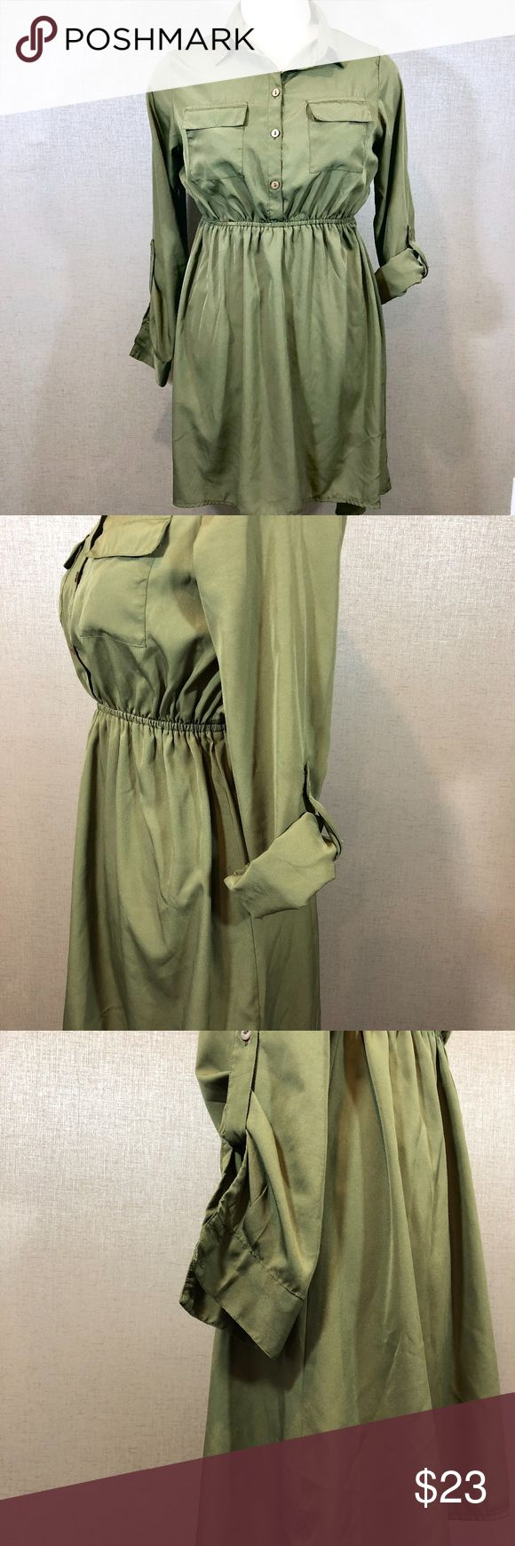 "Olive Green Tunic Dress with Sleeves Up for sale in good preowned condition, Olive Green Tunic/ Dress, fabric is quite thin, but not see through, can be worn together with skinny jeans, leggings or on its own. Please see photos for details. Check out my closet, bundle and give me your offer!  Measurements:  Back Top to Bottom: 38"" Front Top to Bottom: 30.5""   Bust Area:  Waist: 16.5"" Sleeve: 23"" All measurements are approximate and taken flat in the front only. Pink Rose Dresses"
