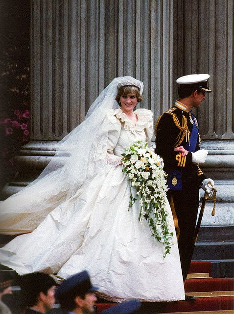 Lady Diana Spencer in her wedding dress. She was married to Charles, Prince of Wales on 29 July 1981 at St Paul's Cathedral. Diana wore an ivory silk taffeta and antique lace gown, with a 25-foot train, valued then at 9,000 English pounds. It became one of the most famous dresses in the world, and was considered one of the most closely guarded secrets in fashion history.  Its commission was a coup for the relatively unknown husband-and-wife design team of David and Elizabeth Emanuel.