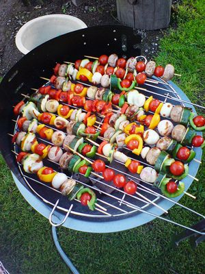 I could make the outside a cookout. Have a few different grills, one for meats and one for veggis kabobs so people could get what they want on the stick then place it on the grill go get their other foods then go and pick it up. would only work for a small wedding.