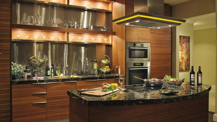 Penthouse State-of-the-Art kitchen which features an island and marble countertops.