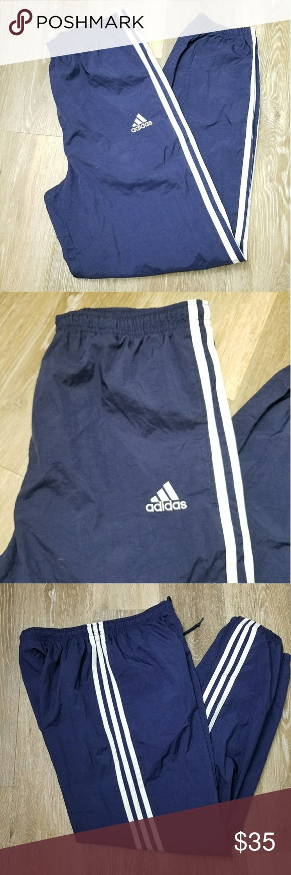 """Adidas Women's Windbreakers Joggers ADIDAS  WINDBREAKER PANTS   WOMENS  SIZE SMALL   NAVY BLUE WITH WHITE STRIPES   ZIPPER ON SIDES OF ANKLES   GENTLY USED   MEASUREMENTS:  LENGTH 39""""  WAIST 30""""  INSEAM 28"""" Adidas Pants Track Pants & Joggers"""