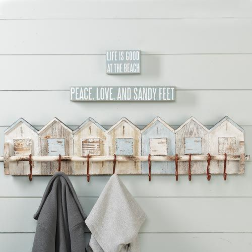 "Beach House Wall Rack -- $69.00 10 hooks across a clever row of delightfully weather-worn mango wood beach houses, aged for delightful effect. 10""h x 47""w x 3.5""d. RSH Catalog.com"
