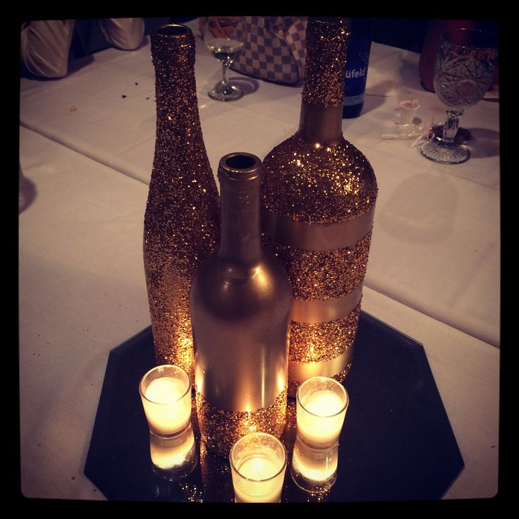 Gold sparkle spray painted wine bottles winebottle for Painted wine bottle wedding centerpieces