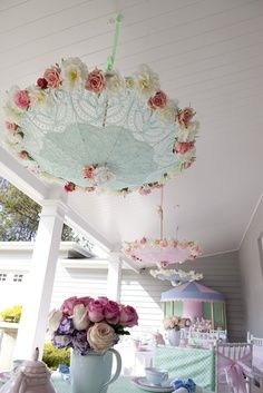 Umbrellas hanging from the ceiling above the table at this Mary Poppins party