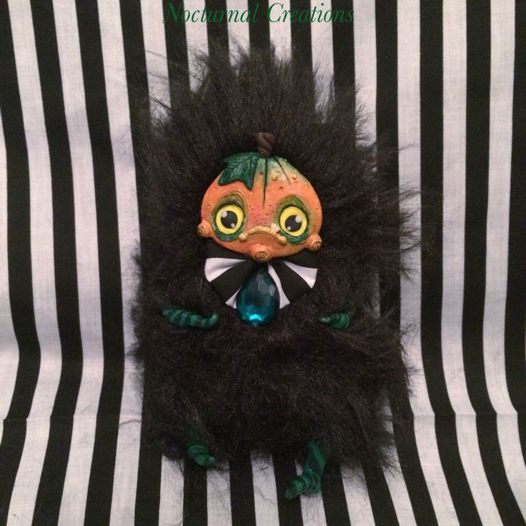 A few of the new art dolls i made for the funsies ^_^ I've had the idea kicking about for a while and decided with #halloween fast approaching it was the perfect excuse to make them  #nocturnalcreations#art #craft #artist #artdoll #arttoy #artistdoll #handmade #diy #doll #fluffy #polymerclay #fauxfur #pumpkin #squash #autumn #fall #thisishalloween #creature #monster #creepy #cute #sculpture #stripes #horror