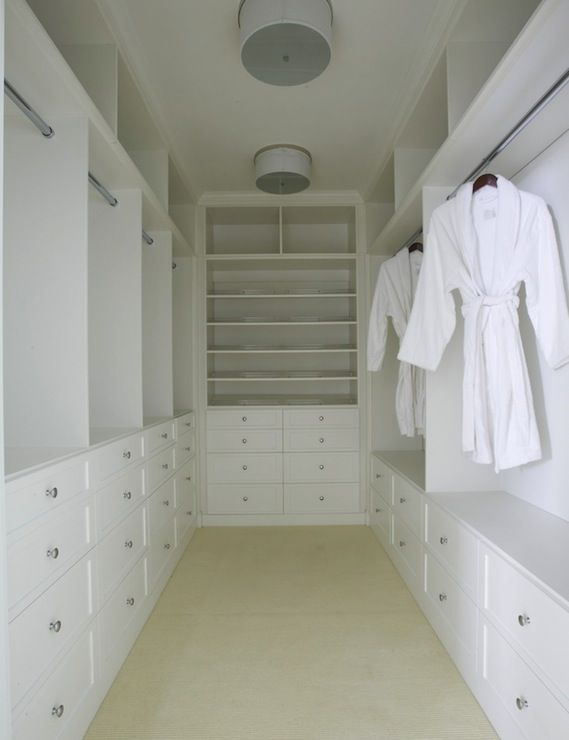 Lynn Morgan Design: Walk-in closet with white built-in cabinets and crystal hardware.