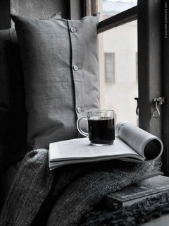 Strong hot tea (with extra lemon) a comfy reading spot and a good book.