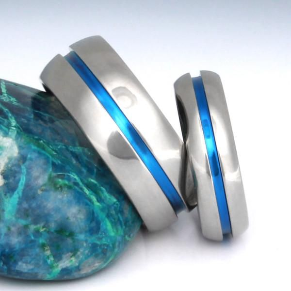 Brighten your blue sky days with this Blue Titanium Ring Set, sporting a bold blue line down the center of each highly polished titanium ring. As a matching set