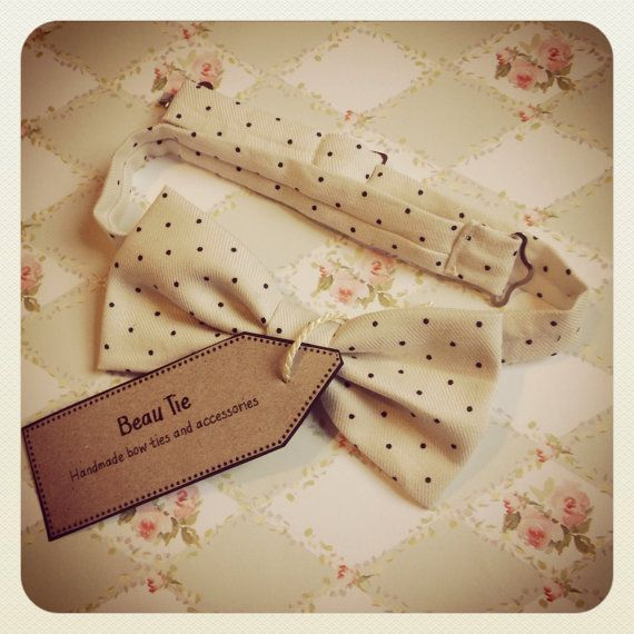 Mens bow tie handmade from cream and black polka dot cotton, by Beau Tie, £26.00