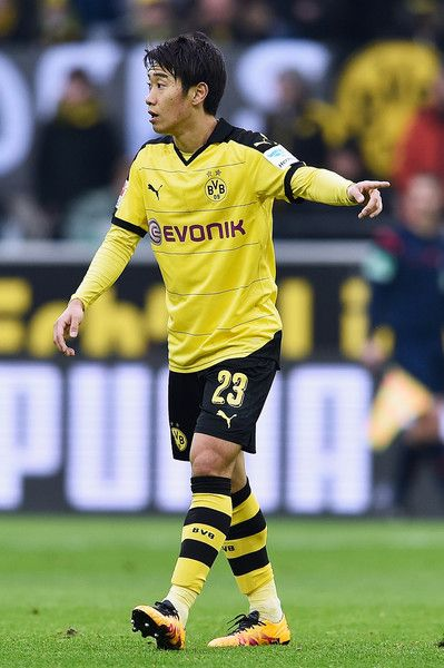 Shinji Kagawa Photos - Shinji Kagawa of Borussia Dortmund reacts during the Bundesliga match between Borussia Dortmund and Hannover 96 at Signal Iduna Park on February 13, 2016 in Dortmund, Germany. - Borussia Dortmund v Hannover 96 - Bundesliga