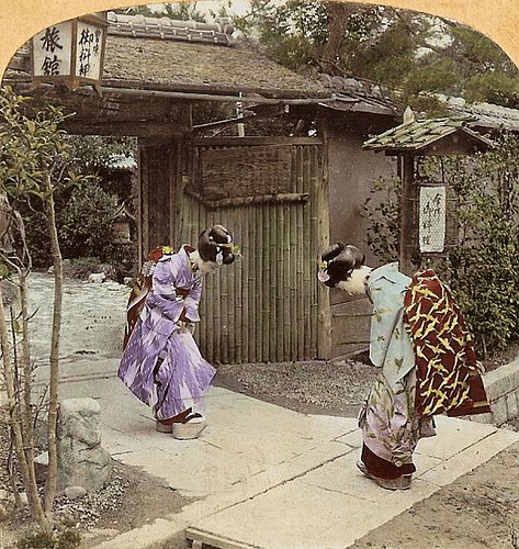 stereoimages by T. Enami documenting life in early 20th century Japan (the Meiji period).  The original hand tinted image (circa 1898), presented for parallel viewing and showing two Maiko meeting at the gate. Note how well the tinting is done, although I'm not a fan of tinted photos..