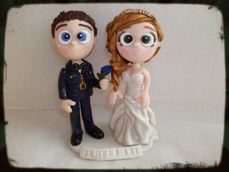 Boogiebabys Cake Toppers Cute cartoon wedding cake toppers, created with your personalised details, this gorgeous couple wanted the Groom to be wearing his Military attire and handing over a blue rose to his Bride. Hope you like xxx