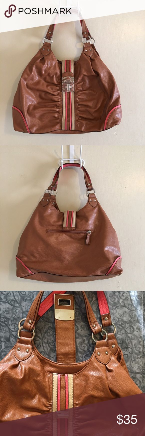 """Jessica Simpson large brown shoulder bag Jessica Simpson large shoulder bag. Brown color with pink & tan/cream accents. Silver hardware. Inside zippered pouch and slip pocket. One large zipper area in the center. Two inner straps make a snap closure (see photo). Bag closes at the top with a long flap and turnlock closure featuring """"Jessica Simpson"""" written in the plate. This is a reposh. This bag is perfect but it's not a crossbody, which is it's only downfall. On the fence about selling…"""