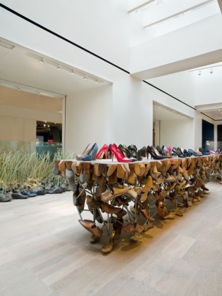 Selfridges shoe department, London. The display is completely different than any shoe department I have ever seen. The shoes are used almost as planters in the back with vines sprouting. The shoes on the middle display look haphazard with some order. You can tell they are specifically placed, but with no real order. The eye is drawn to the overall uniqueness of the display. The bright colored shoes on the top shelf definitely steal the show and pull the eyes in to these items as well.