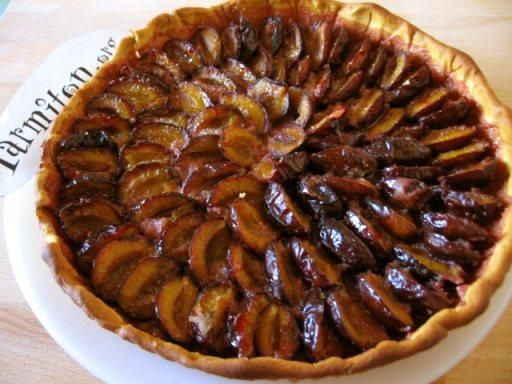 """ALSACE FRENCH PLUM TART~ Tarte aux Quetsches d Alsace. Typical tart of the ALSACE region of France. Italian blue prune plums are very much like the French """"Quetsche"""" Not very juicy, and rarely eaten raw, the Quetsche is the perfect fruit for Autumn tarts. They turn a beautiful rosy red when baked."""
