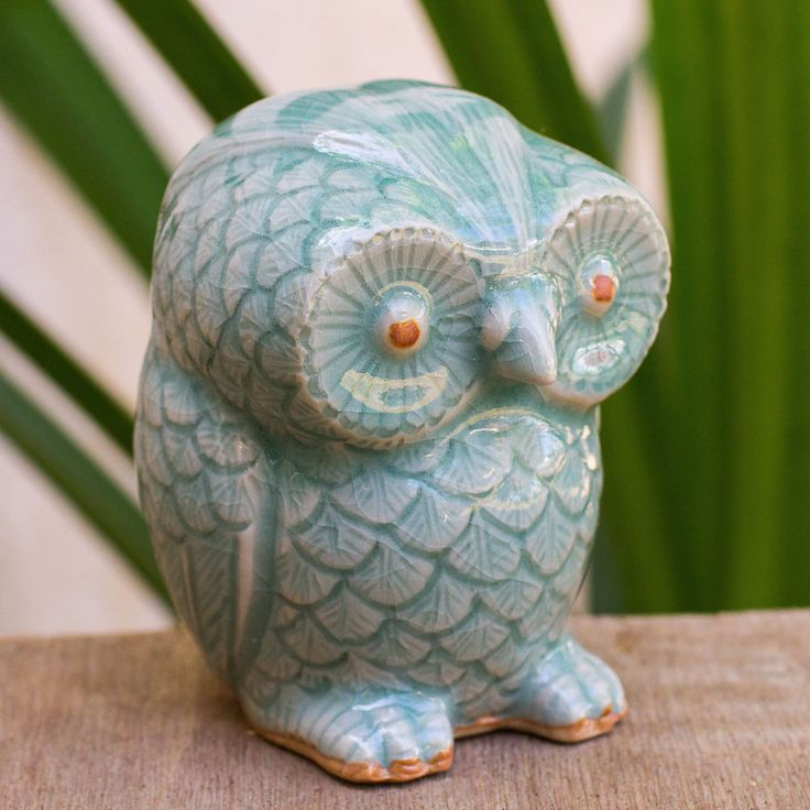Crafted by hand from celadon ceramic, the figurine depicts the wise little bird flaunting its pale blue feathers.