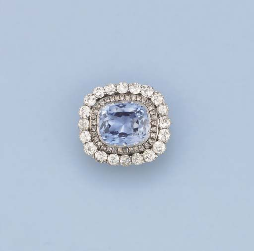 AN ANTIQUE SAPPHIRE AND DIAMOND BROOCH   The central cushion-shaped sapphire within rose-cut diamond surround to the old-cut diamond border, later rhodium plated, circa 1890, 3.0 cm. wide