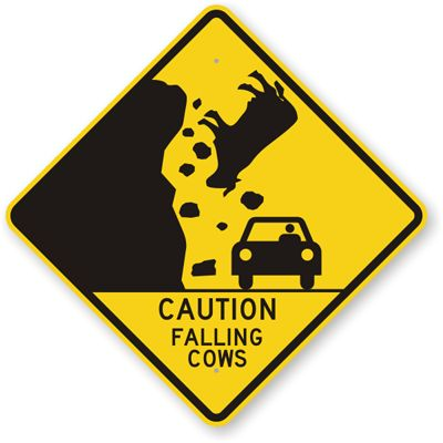 street sign, yellow, falling cow