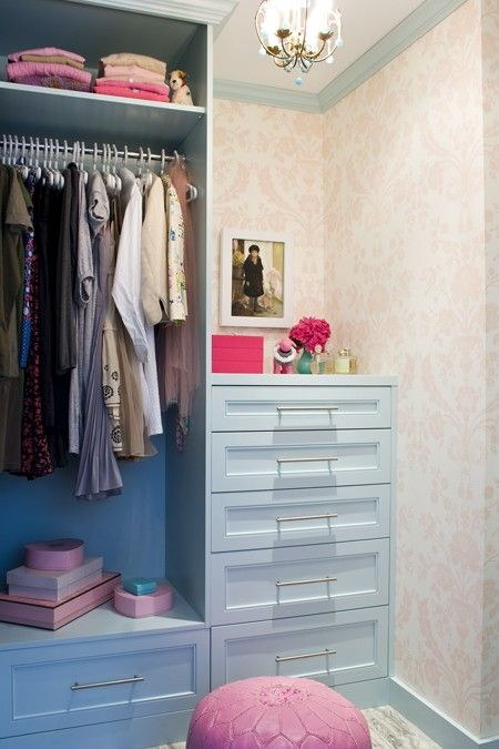 Compartmentalized closet. Love how the hangers don't stick out past the dividing wall.