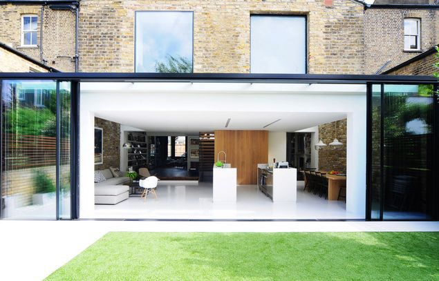 Open-plan folding doors help to make this a complete success as a contemporary extension added on to a period house...