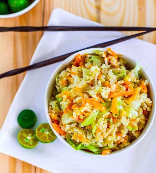 Skinny Garlic Fried Rice  2 cups cooked, cold brown rice  3 tablespoons oil, divided  1/2 head green cabbage, shredded  1 large carrot, shredded  (& any other veggies you want)  1 yellow onion, diced  4 cloves garlic, grated or minced  1 1-inch piece ginger, grated or minced