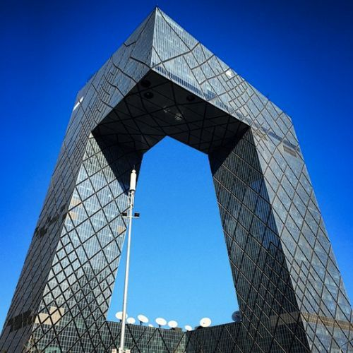 CCTV HEADQUARTERS, BEIJING, CHINA The offices of the largest state-run television network in mainland China almost look too futuristic to be real: The skyscraper consists of two forward-leaning towers joined at the top, forming a loop. The timelapse video of the construction shows you just how far technology has come.