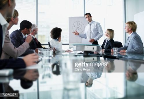 Stock Photo : Group of office workers in a boardroom presentation