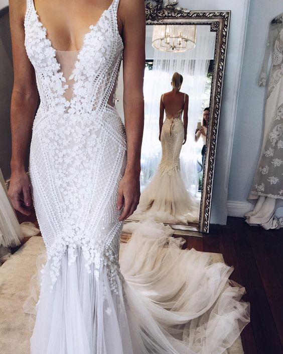 Plunging neckline low back intricate beading wedding gown