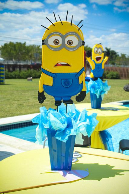 Fun centerpieces at a Minions Birthday Party! See more party ideas at CatchMyParty.com!