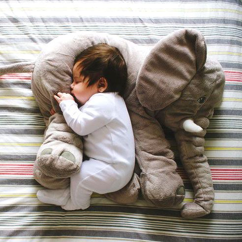 This soft and cuddly elephant plush pillow makes a great gift for people of any age who love stuffed animals! It's perfect for babies who can use it as a pillow and cuddle up into it. When baby gets a little older, she will love carrying her elephant friend around with her everywhere she goes. This would make a great gift for a baby shower, birthday, anniversary, Christmas, or Valentine's Day!