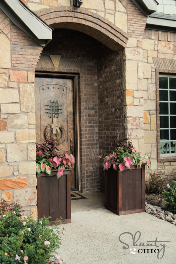 LOVE this cute door and the cute planter boxes!  Makes great curb appeal!  <3
