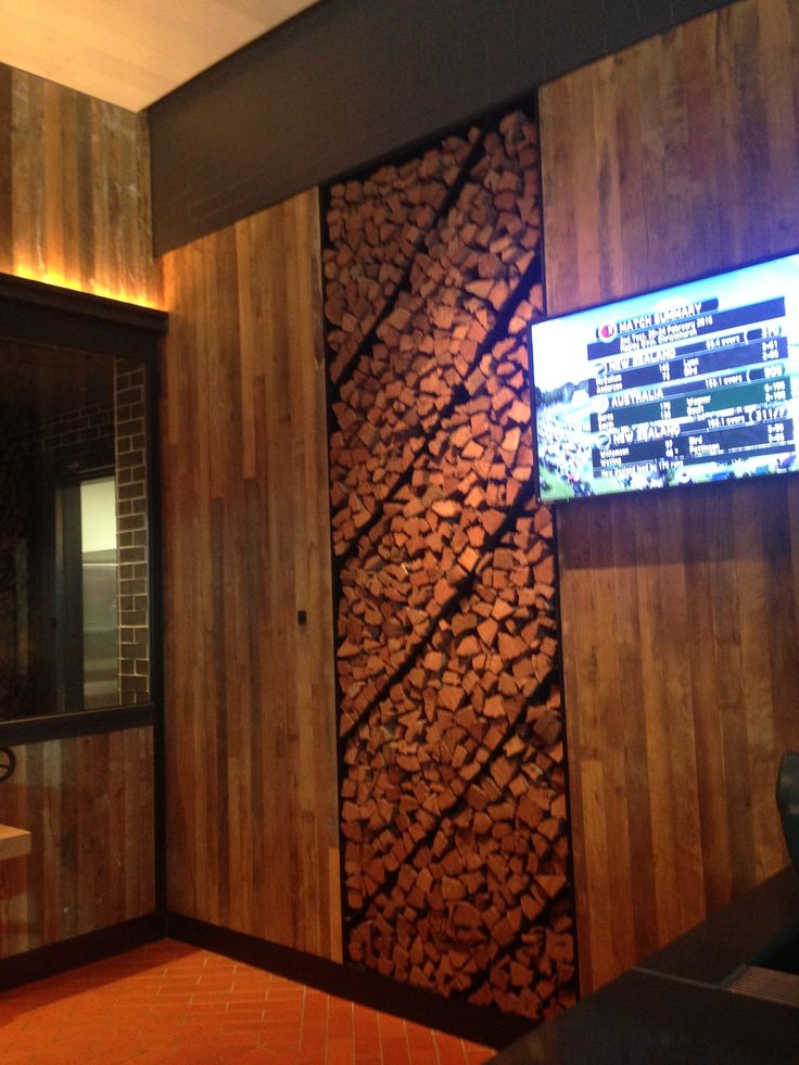 PHOTO 5: Timber feature wall and panel of logs adds a warmth to the space, also contributing to their outback vibe.