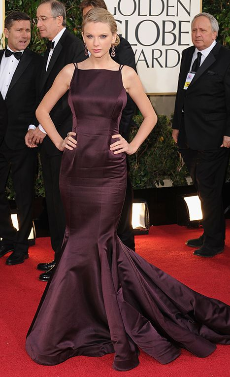 Taylor Swift wore a dark plum taffeta Donna Karan Atelier gown with a sexy low back and dramatic train to the 2013 Golden Globes.