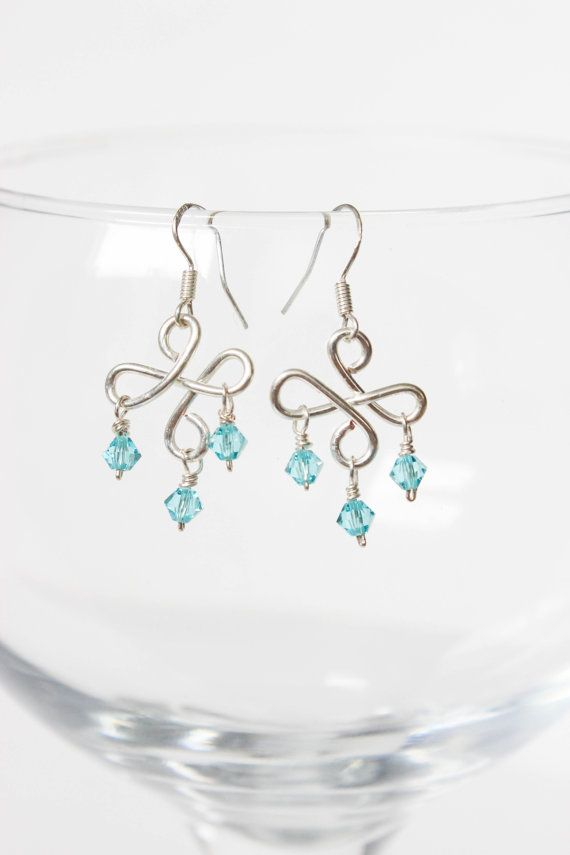 These bright aqua crystal earrings catch the light so beautifully when the crystals move with your movement that they are sure to catch everyones eye. They hang approximately 1 inch and are made from Swarovski crystal beads, and silver plated jewelry wire that is tarnish resistant.