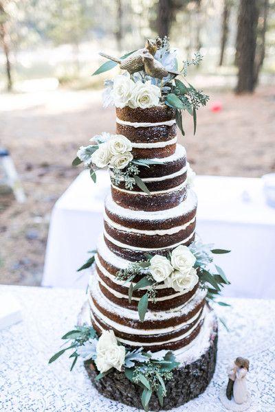 Unique naked wedding cake idea - naked chocolate wedding cake with white frosting + ivory roses and eucalyptus + bird figurine cake topper {Jacquelynn Brynn Photography}