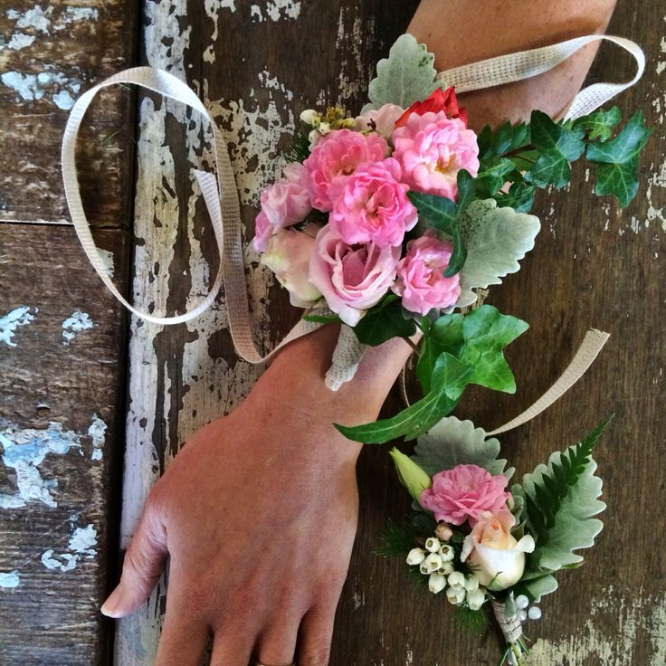 A matching his and hers wrist corsage and buttonhole for an end of Year 10 school formal