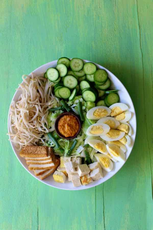 As an authentic and traditional Indonesian vegetarian recipe, gado gado salad is famous for its spicy peanut sauce and fried tofu.