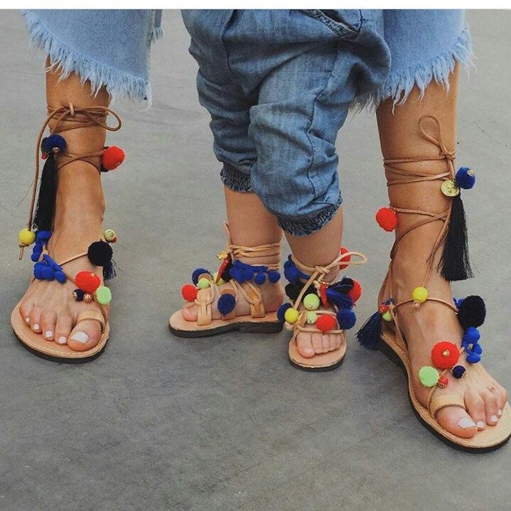 Mamy and daughter with happy pom pom sandals .