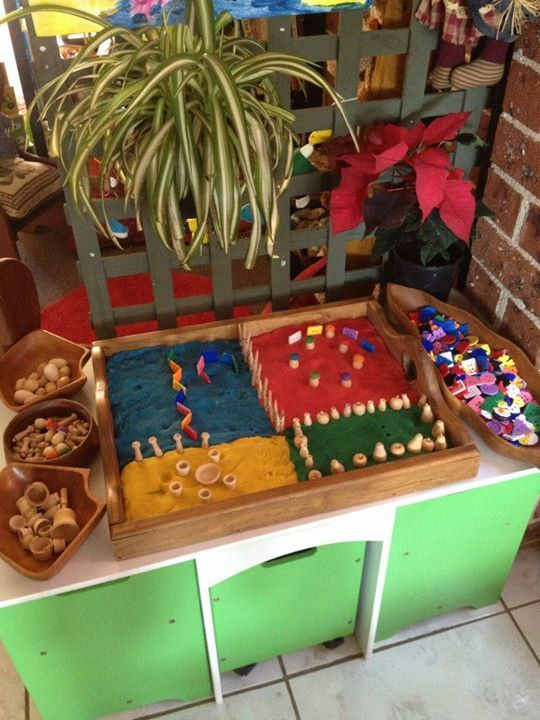 "I love this play dough tray area at Puzzles Family Day Care ("",)"