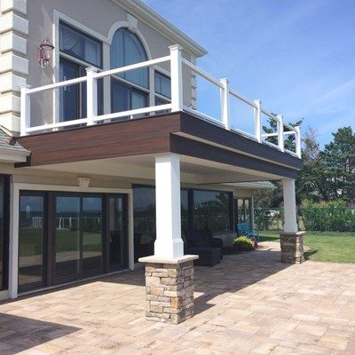 Custom Built water front Deck includes Trex transcends Decking ,Glass railing system,Steel galvanized beam ,Dry proof drain system with hidden gutter and LED lighting
