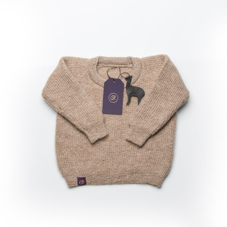Our beautifully knitted, all natural alpaca fibre sweater. Hypoallergenic, water repellant and no dyes!
