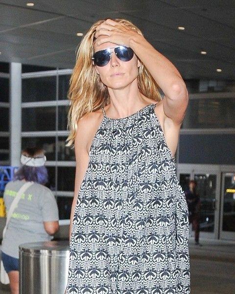 Heidi Klum and her boyfriend touch down at LAX.