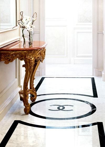 I adore the luxury feel of wainscoting, marble and/or granite...plus with the Chanel logo is fabulous!
