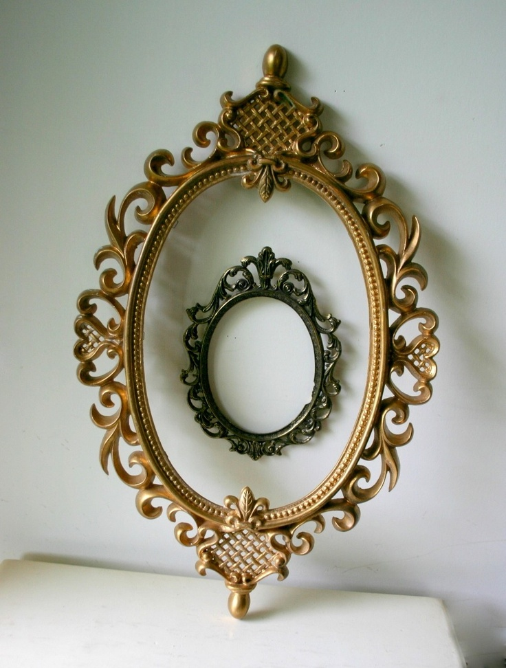 set of vintage ornate oval frames