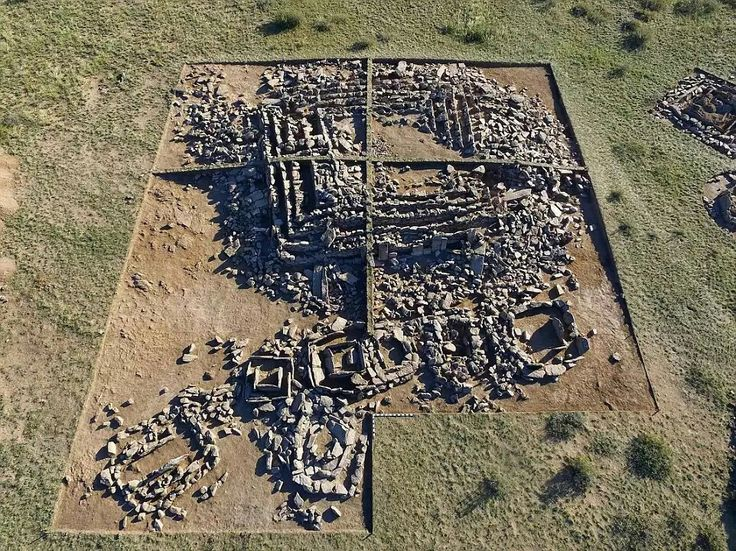The bronze era pyramid found in Kazakhstan. These photos show artifacts already unearthed at the site, and the layout of the foundations of the pyramid, before archeologists examine an unopened burial chamber in coming days.  Read more: http://www.dailymail.co.uk/news/article-3741937/Scientists-discover-known-pyramid-Kazakhstan-structure-built-1-000-years-Egypt-s-similar-tomb-Djoser.html#ixzz4kUYJkmSn  Follow us: @MailOnline on Twitter | DailyMail on Facebook
