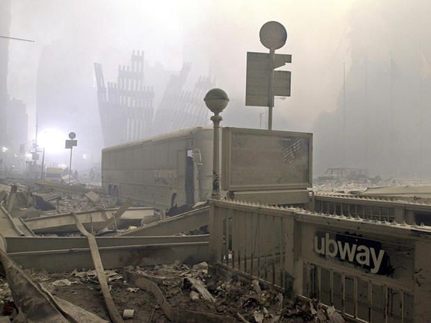 A subway entrance is covered in debris at the intersection of Church and Dey Streets after the World Trade Center collapse in New York City on Sept. 11, 2001.