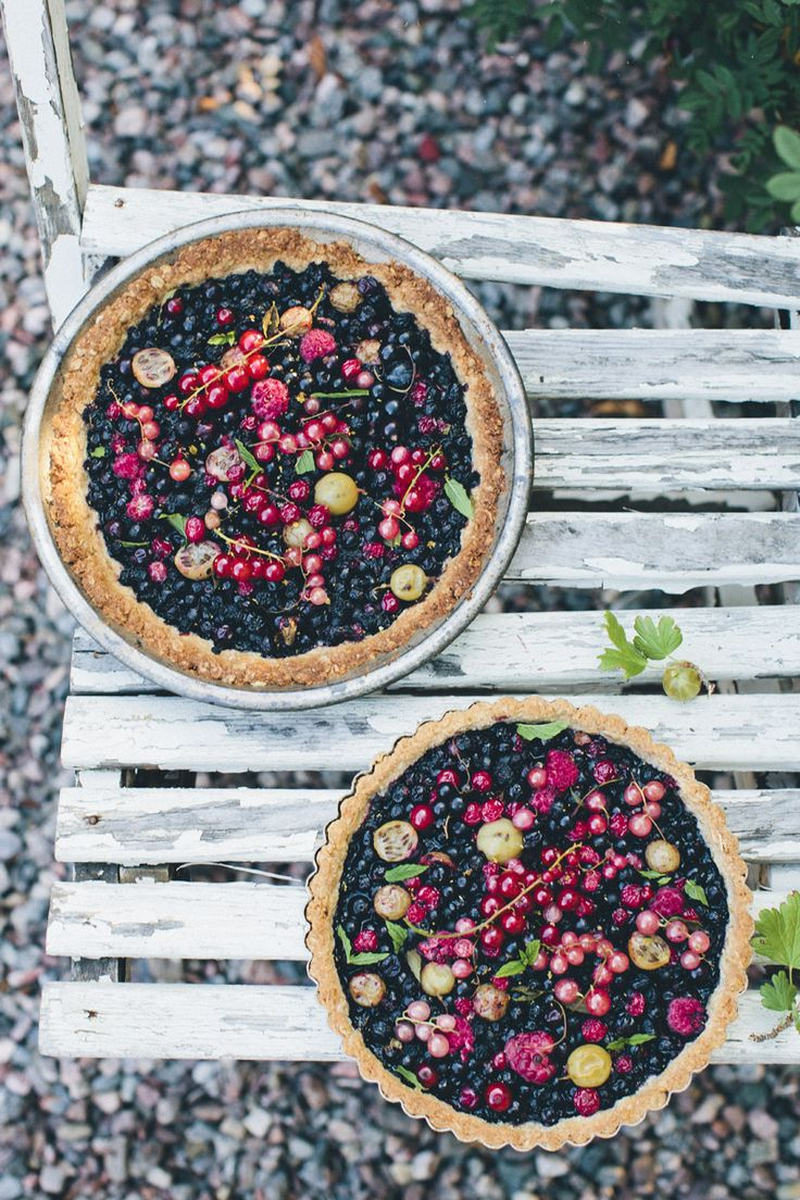 Wild berry tart with almond and oat crust (shown here with blueberries + raspberries + gooseberries + red currants), via Green Kitchen Stories blog