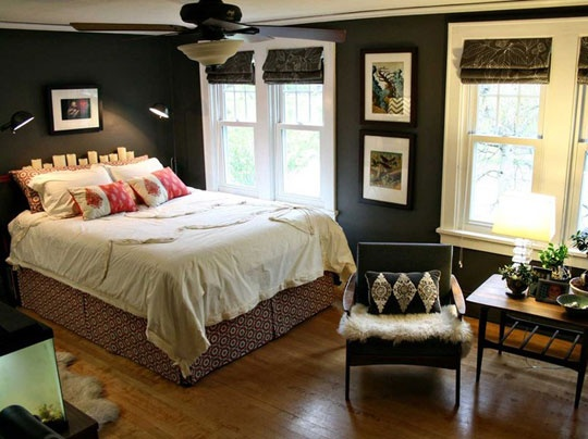 love the dark color, white trim and matching dark roman shades in this bedroom.  So inviting!